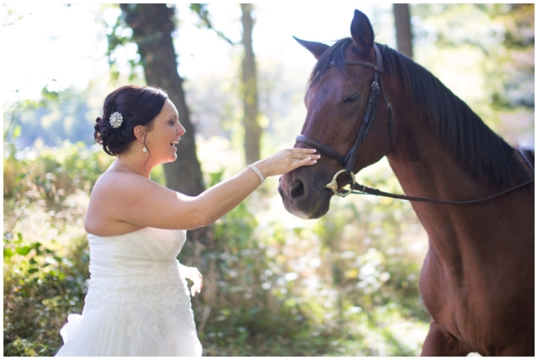 bride and horse 5th Photography des moines wedding photographers